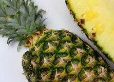Pineapple halves on a white background Stock Photography