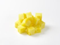Pineapple. Heap of pineapple slices on white background Stock Photography