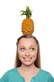 Pineapple on her head. Stock Images