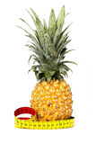 Pineapple isolated on white. Pineapple and measuring tape isolated on white Royalty Free Stock Photography
