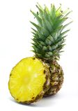 Pineapple with its slice. Isolated on white background Stock Photo