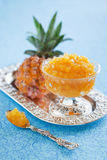 Pineapple jam. Homemade ??pineapple jam and fresh pineapple, selective focus Royalty Free Stock Images