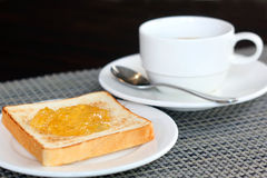 Pineapple jam on bread and coffee Royalty Free Stock Photography