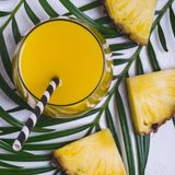 Pineapple juice or cocktail on white background closeup royalty free stock photos