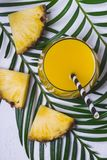 Pineapple juice or cocktail on white background closeup stock photos