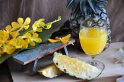 Pineapple Juice with Fresh Pineapple on Background Royalty Free Stock Photos