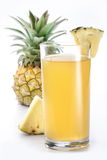 Pineapple juice and fruit. Royalty Free Stock Image