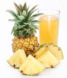 Pineapple juice and fruit. Stock Photos