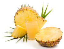 Pineapple juice in a glass and  pineapple Royalty Free Stock Image