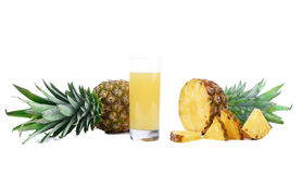 Pineapple juice in a glass and slices. Stock Photography