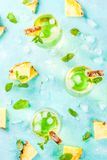 Pineapple juice margarita. Tropical drink, Pineapple juice margarita cocktail with fresh mint, light blue background copy space top view Stock Photography