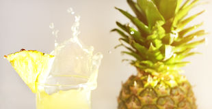 Pineapple juice and pineapple. On a light background Stock Images