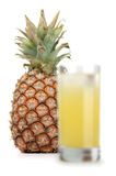 Pineapple and juice of pineapple. The big, ripe, juicy pineapple on a white background Royalty Free Stock Images