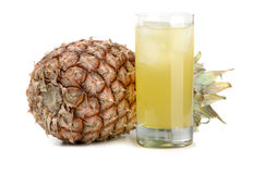 Pineapple and juice of pineapple. The big, ripe, juicy pineapple on a white background Royalty Free Stock Photo
