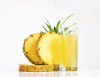 Pineapple juice with sliced pineapple. Fresh pineapple juice with sliced pineapple on white background Royalty Free Stock Image