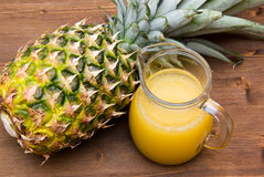Pineapple juice on wood from above Royalty Free Stock Photos