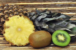 Pineapple and kiwi. Fruit still life with kiwi and pineapple royalty free stock images