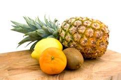 Pineapple, kiwi, mandarin and lemon Royalty Free Stock Images