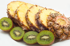 Pineapple and kiwi on a plate Stock Photo
