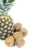 Pineapple and kiwis Stock Photography
