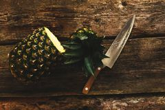 Pineapple with knife Stock Photo