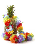 Pineapple and Lei. Colorful lei draped over a fresh pineapple Stock Photo