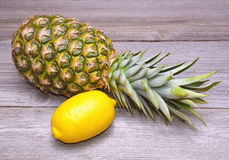 Pineapple and lemon Stock Images