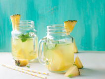 Pineapple lemonade. With lemon and mint, selective focus Royalty Free Stock Photos