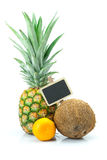 Pineapple, mandarin , coconut and board Stock Images