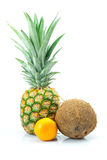 Pineapple, mandarin and coconut isolated on white Royalty Free Stock Images