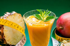 Pineapple mango smoothie, ingredients and centimeter. Royalty Free Stock Photo