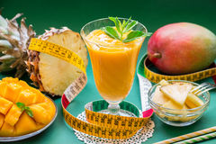 Pineapple mango smoothie, ingredients and centimeter. Stock Photo