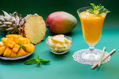 Pineapple mango smoothie and ingredients. Royalty Free Stock Images