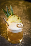 Pineapple mango tropical rum cocktail drink in bar Stock Images