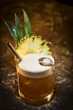 Pineapple mango tropical rum cocktail drink in bar Royalty Free Stock Images