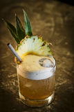 Pineapple mango tropical rum cocktail drink in bar Stock Photography