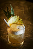 Pineapple mango tropical rum cocktail drink in bar Stock Photo