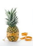Pineapple with measurement tape Stock Photos