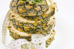 Pineapple  and measuring ribbon Royalty Free Stock Photography