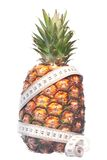 Pineapple with measuring tape Royalty Free Stock Image
