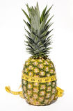 Pineapple with measuring tape Stock Images