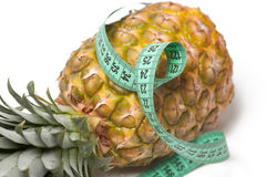 Pineapple with measuring tape Royalty Free Stock Photos