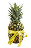 Pineapple with measuring tape. Royalty Free Stock Images