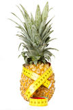 Pineapple with measuring tape. Isolated on white Stock Photography