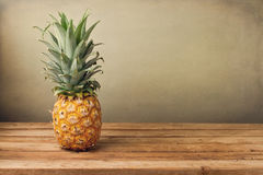 Pineapple On Wooden Table Stock Image
