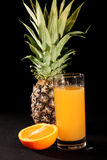 Pineapple and orange juice Royalty Free Stock Images