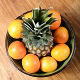 Pineapple and oranges in a bowl Royalty Free Stock Image