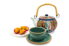 Pineapple pastry and Teapot Stock Photos