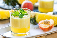 Pineapple with Peach smoothie Stock Images