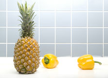Pineapple And Peppers. ON Closeup Stock Photo